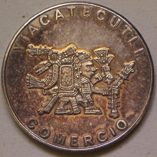 Coin picture of obverse of a 1 ounce silver Yiacatecutli Comercio of Mexico medal 1978