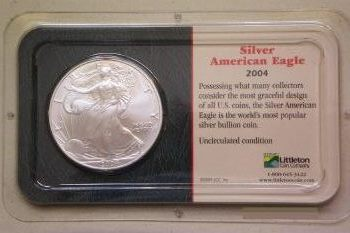 Coin picture of obverse of a 1 ounce silver US Eagle 1 Dollar 2004 sealed version