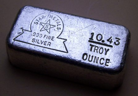 Ingot image of a 10.43 ounces solid .999 silver US Star Mint loaf style bar hand poured sealed in mylar pack