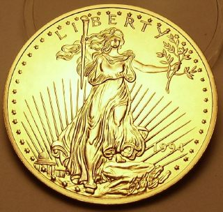 Ingot image of obverse of a 8 ounces gold plated solid .999 silver USA Washington Mint St. Gaudens Eagle