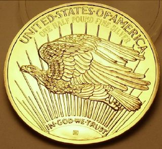 Ingot image of reverse of a 8 ounces gold plated solid .999 silver USA Washington Mint St. Gaudens Eagle
